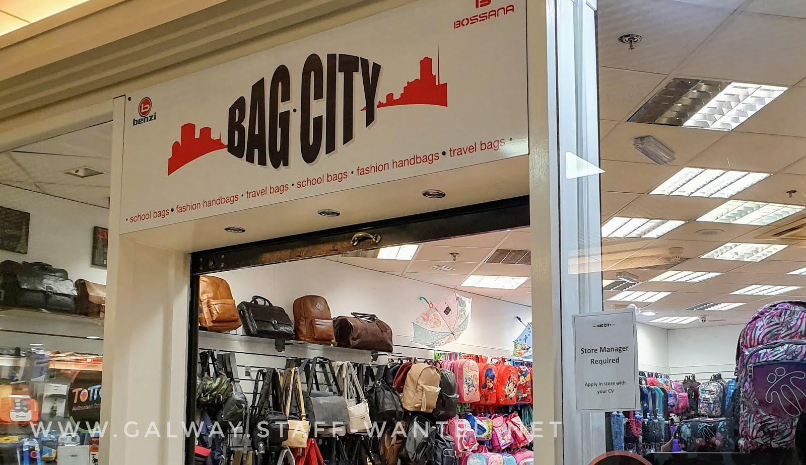 shop front with signage and bags on display:  bag city - schoolbags - fashion handbags - travel bags - Galway city centre - open seven days