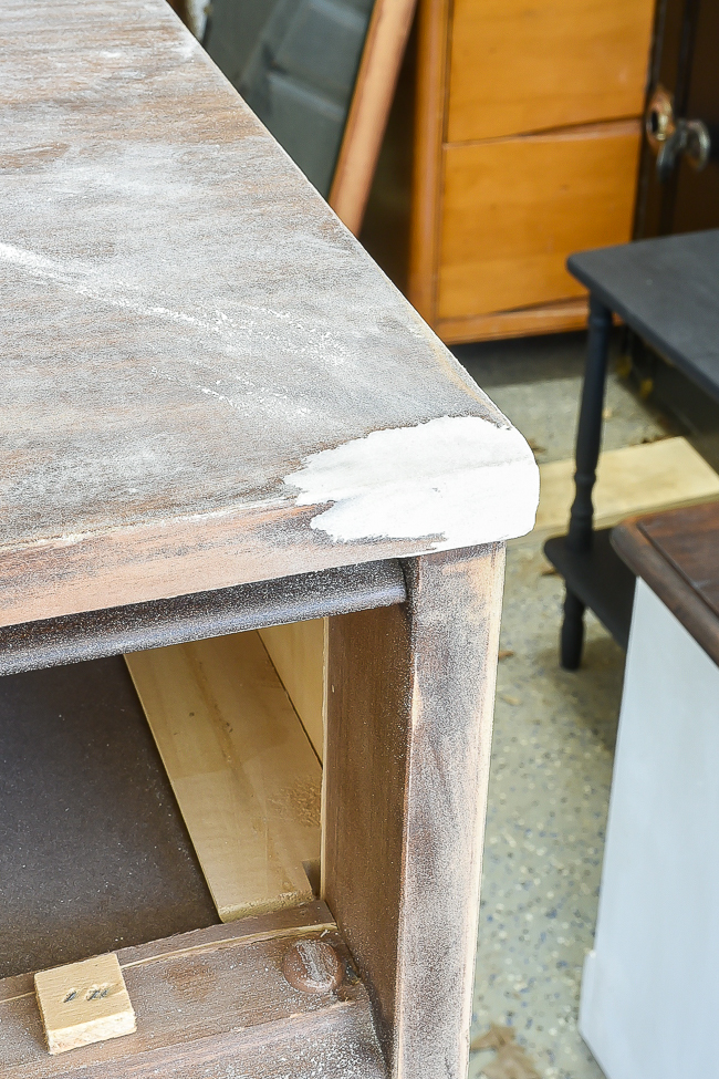 Repaired corner of damaged furniture