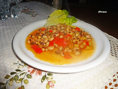 tasty dish with black pepper beans cooked with peppers, onion and tomatoes