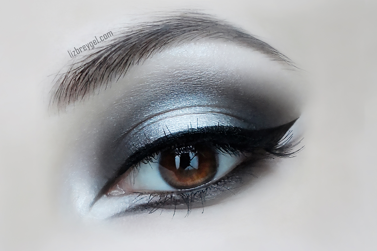 a close-up picture of an eye with dramatic Gothic makeup look