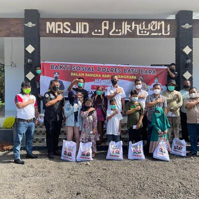 Sambut Hari Bhayangkara ke 75,Satreskrim Polres Batubara Lakukan Bakti Sosial Pengaspalan Area Mesjid Al Ikhwan