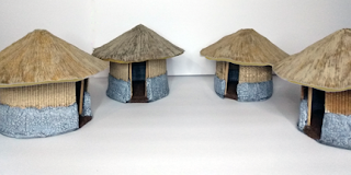 Four finished huts