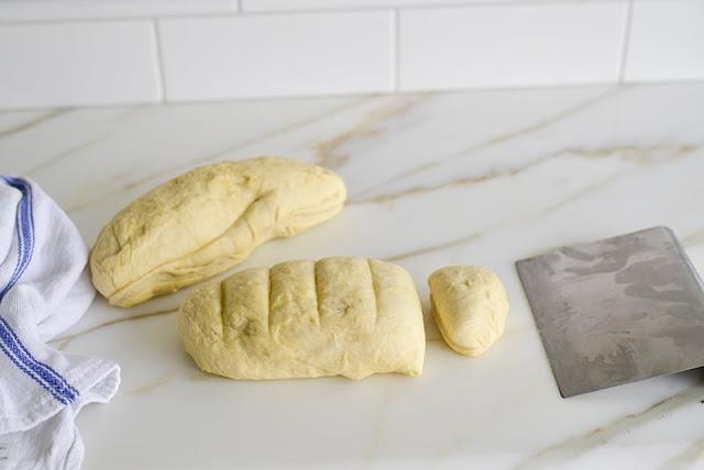 Pita dough scored for benching