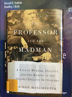 The Professor and the Madman: A Tale of Murder, Insanity, and the Making of the Oxford English Dictionary, by Simon Winchester, superimposed on Intermediate Physics for Medicine and Biology.