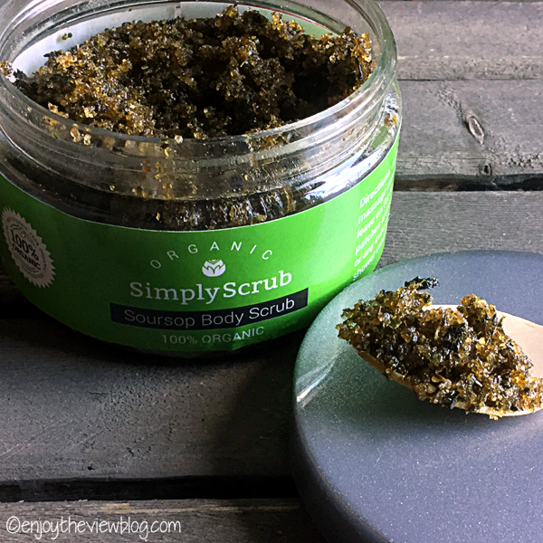 open jar of Simply Scrub Organic Soursop Body Scrub sitting on a wooden table