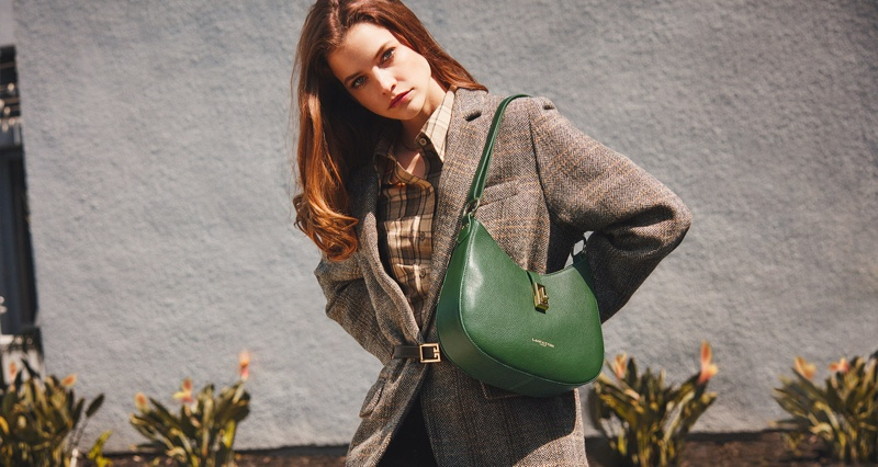 Posing with a pine green shoulder bag, Barbara Palvin fronts Lancaster fall-winter 2021 campaign.
