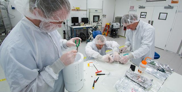 Assembly of the prototype for the LZ detector's core, known as a time projection chamber (TPC). From left: Jeremy Mock (State University of New York/Berkeley Lab), Knut Skarpaas, and Robert Conley. (Credit: SLAC National Accelerator Laboratory)
