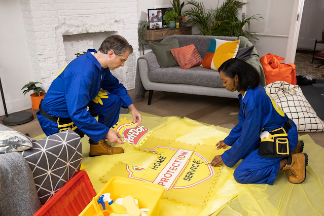 Image provided by Hasbro of the Home Protection Service setting up in a house with floor coverings