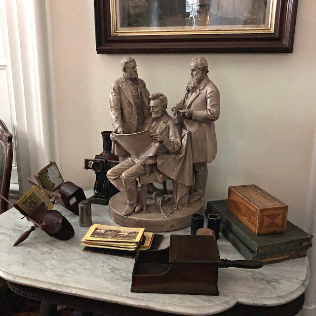 Magnificent Lincoln sculpture surrounded by stereoscopes.