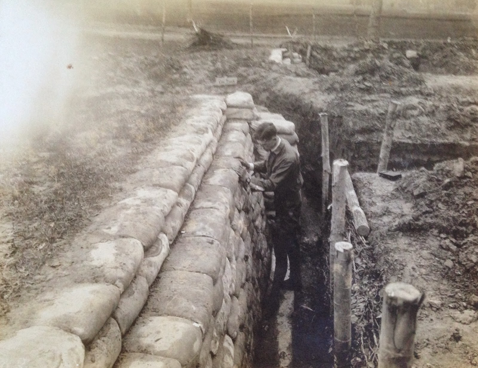A photograph of a man standing in a training trench.