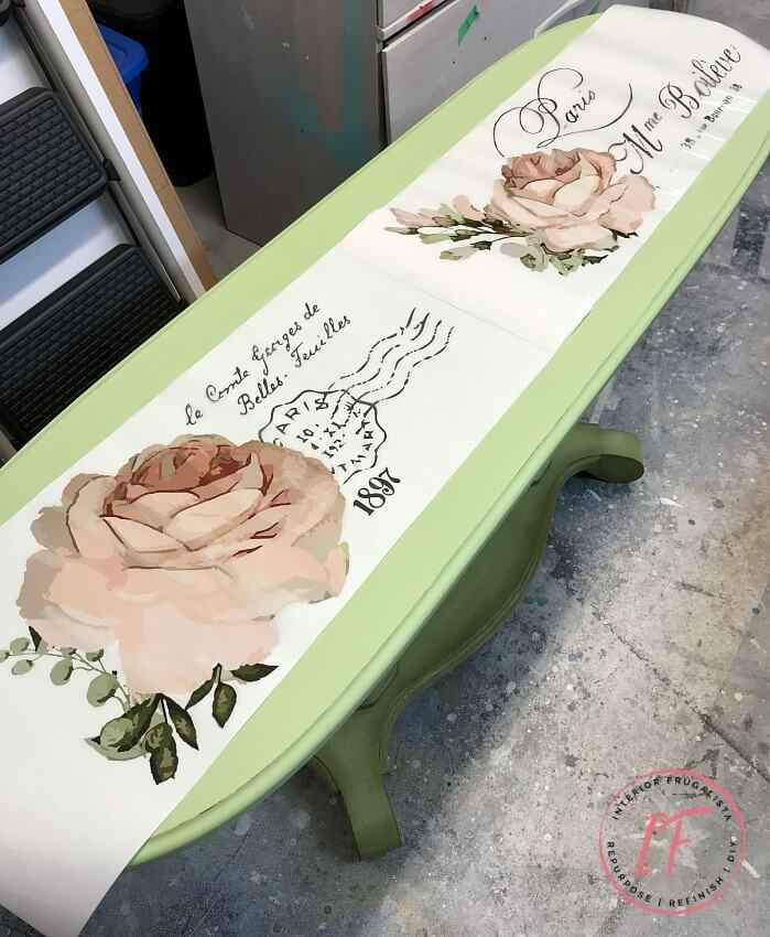 A long oval golden oak empire style console table makeover with French Country Charm with a gorgeous Chatellerault furniture transfer and green paint.