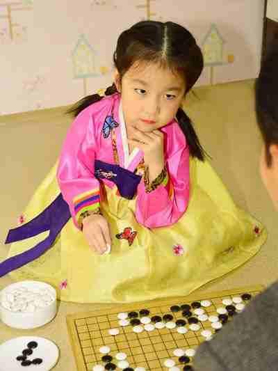 Choe Ryo Jong, a pianist and paduk player, at Ryomyong Kindergarten