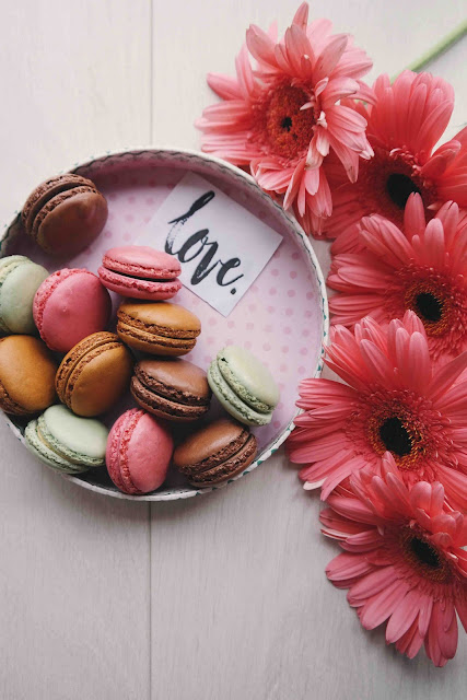 Love of Macarons and Pink Gerbera Daisies | Photo by Brigitte Tohm via Unsplash
