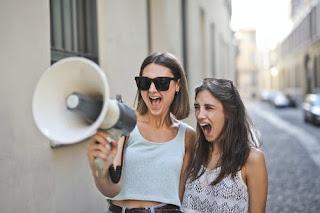 woman-screaming-in-loudspeaker