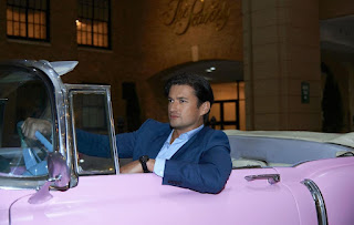 Actor Wes Brown  driving a classic car