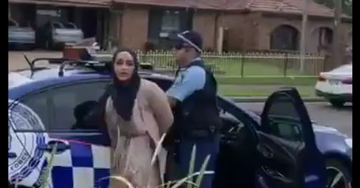 Hijab-wearing women spits on a Sydney officer