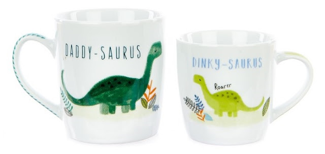 A large and small mug with dinosaurs on