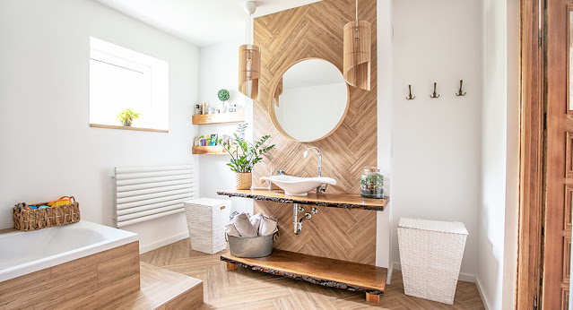 A little boho design in this bathroom (light wood and organic shaped lighting) makes for beautiful mid-century modern design.