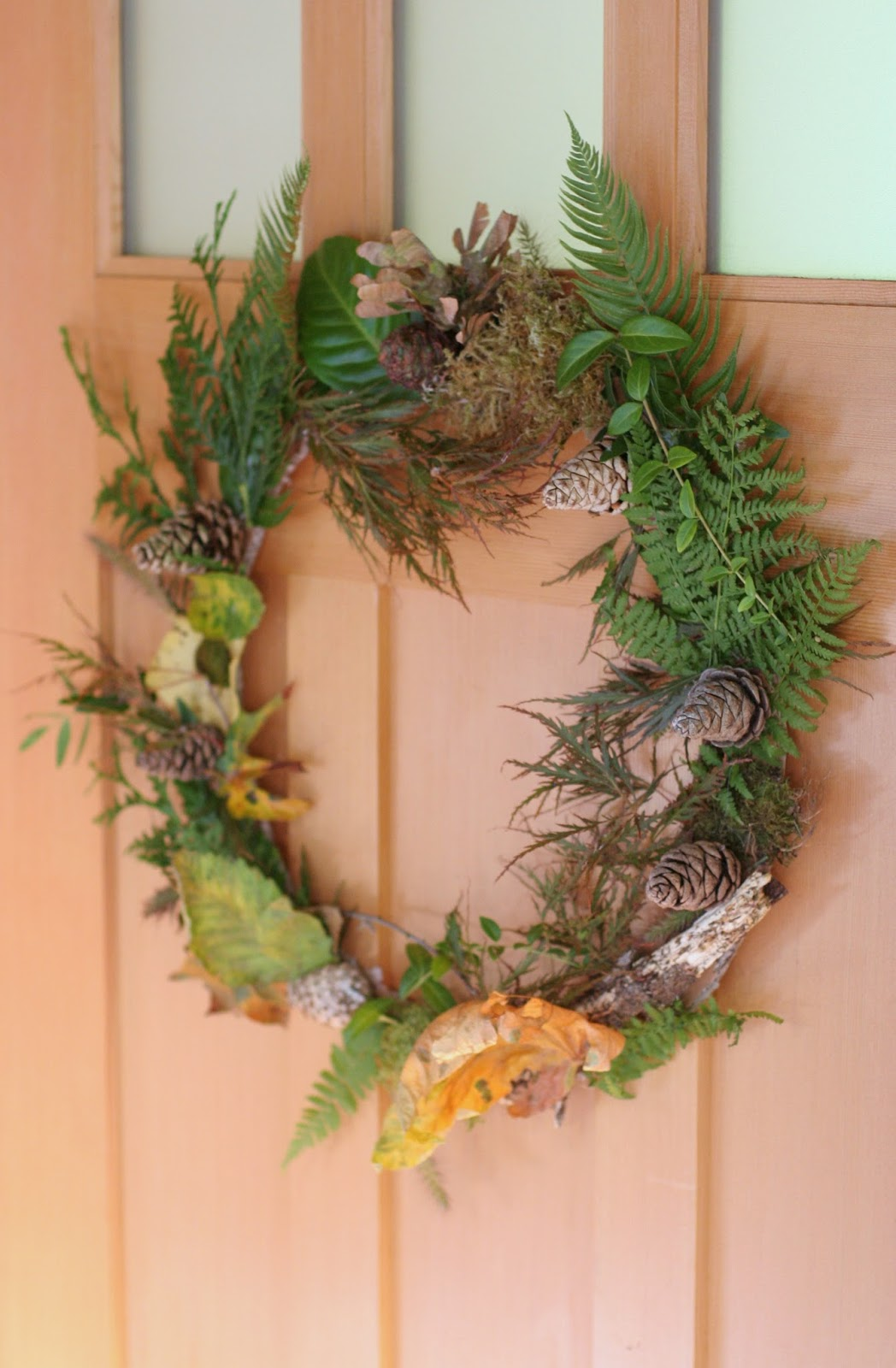 Kid-Made Fall Nature Wreaths made with recycled and natural items!  Quick and easy to make and so beautiful - a 4 year old made this wreath!  From Fun at Home with Kids