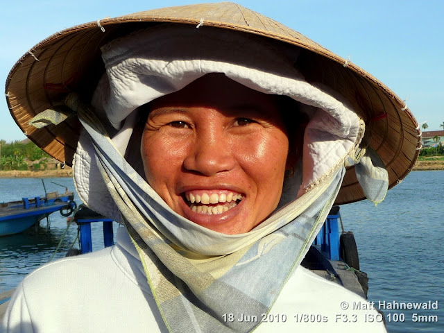 Asian conical hat, conical straw hat, Vietnamese style conical hat, nón lá, sedge hat, rice hat, paddy hat, Vietnamese woman, portrait, headshot, Vietnam, Hoi An