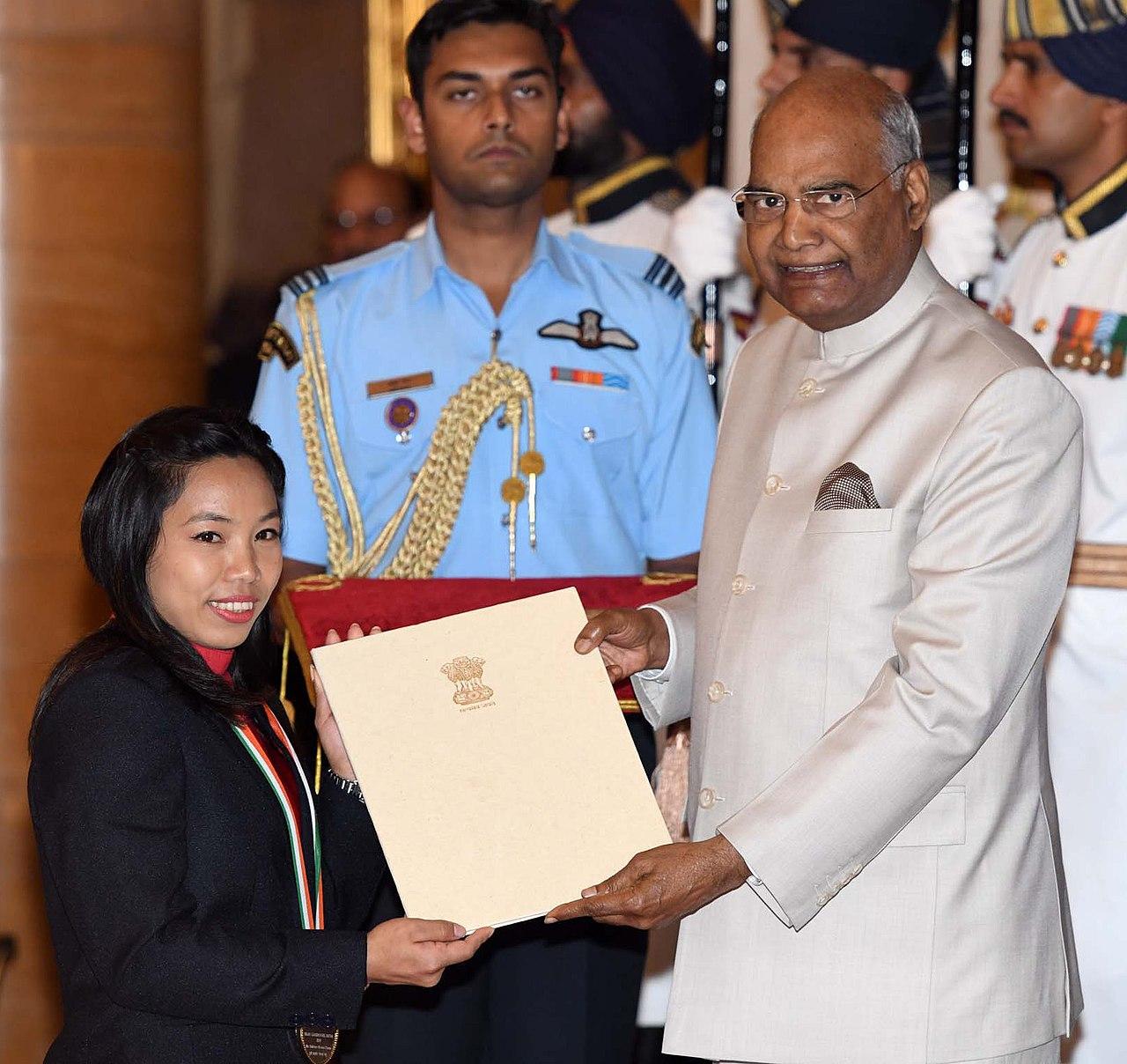 Mira Bai Chanu Biography in Assamese language