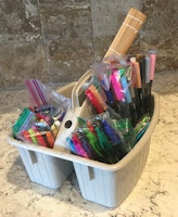 Plastic bin of art supplies
