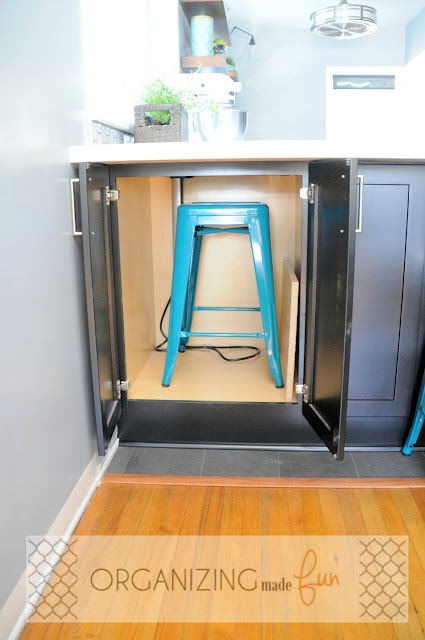 Hidden cabinet on peninsula to hold extra stool :: OrganizingMadeFun.com
