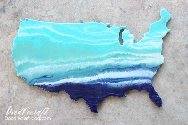 How to do an Ocean Resin Pour on USA Cutout DIY tutorial to make home decor look like the waves of the ocean in ombre shades of blue.
