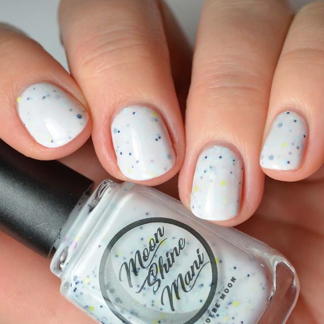 white crelly nail polish with assorted glitter swatch