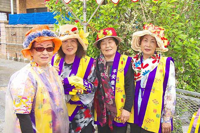 4 ladies,costumes, hats, flowers