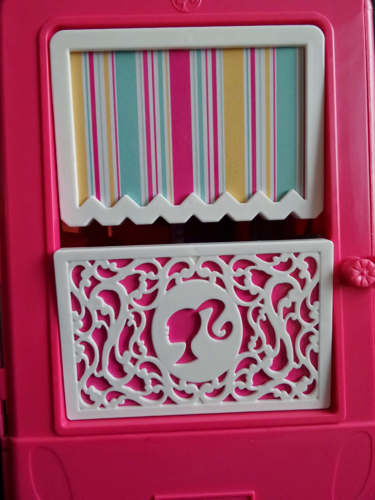 The outside of the back panel of the Barbie Glam Camper #Review