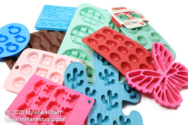 An assortment of colourful ice cube and cake decorating silicone moulds