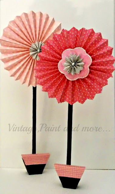 Vintage, Paint and more... giant pinwheel flowers made from scrapbook paper and scrap lumber