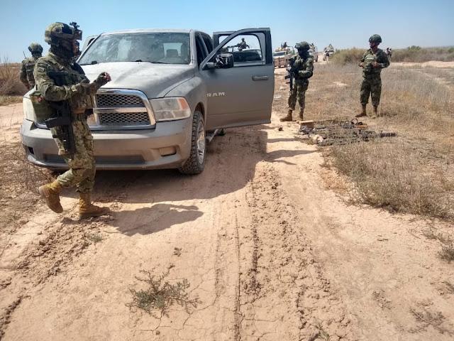 Fotografias; Marinos encuentran Camionetas y armas que Sicarios abandonaron en brecha en Caborca; Sonora