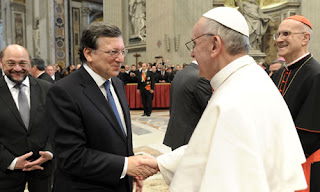 Catholic Pope Francis shakes hands with president of the European Commission
