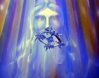 Fotograma de Ulises 31 que muestra la nave Odiseus y al fondo una inmensa imagen con el rostro de Zeus