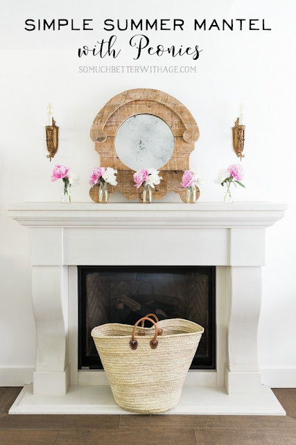 Simple summer mantel with pink peonies.