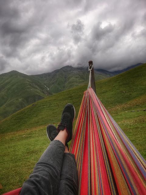 person laying in hammock, unsplash.com