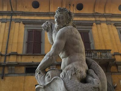 Fontana del delfino with Palazzo Lupi
