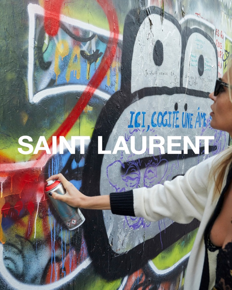 Kate Moss spray paints in Saint Laurent spring 2021 campaign.