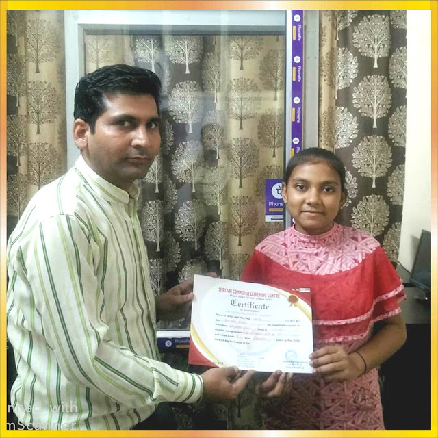 student taking certificate from teacher