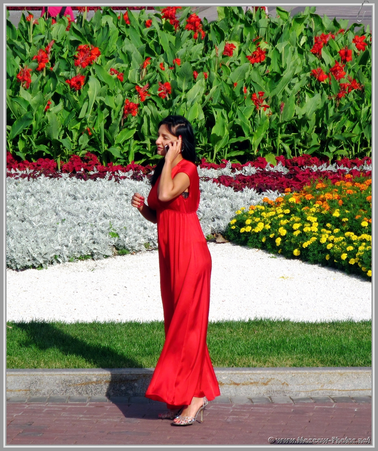 Elegant and businesslike against the background of a flower bed