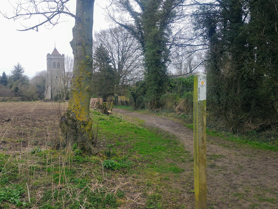 Follow the track through the churchyard and back to the start of the walk