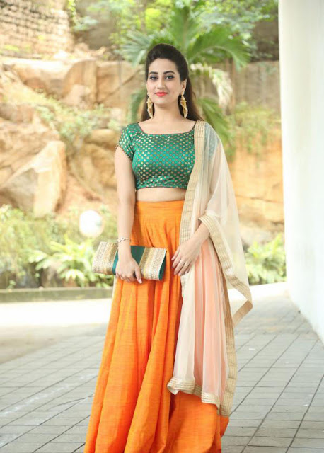 Anchor Manjusha in Orange Raw Silk Lehenga