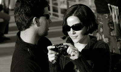 7 Surefire Ways to Attract Hot Women , man woman cameras sun glasses black and white