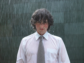 Businessman standing in pouring rain