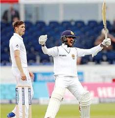 Sri Lanka go down fighting