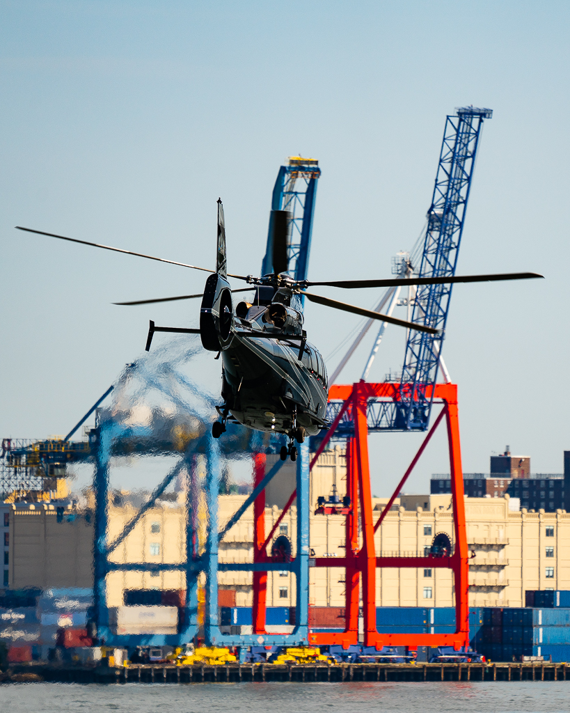 a photo of a Black Helicopter With Cranes new york city