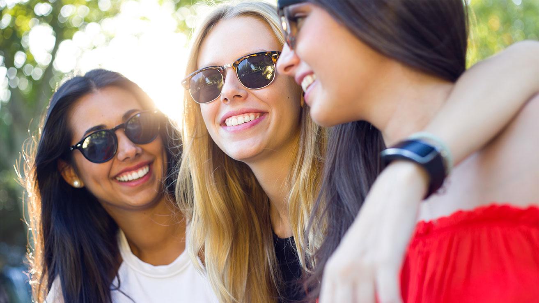 Three girls laughing.