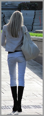 Slim blonde girl in white jeans on the street